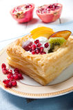Delicious puff pastry with cream and fruits Royalty Free Stock Images