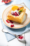 Delicious puff pastry with cream and fruits Stock Images
