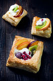 Delicious puff pastry with cream and fruits Stock Photography