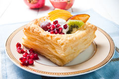 Delicious puff pastry with cream and fruits Stock Photos