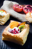 Delicious puff pastry with cream and fruits Royalty Free Stock Photography
