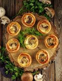 Delicious puff pastry with mushrooms on th wooden table, rustic Stock Photo