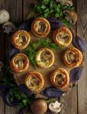 Delicious puff pastry with mushrooms on th wooden table, rustic Stock Images