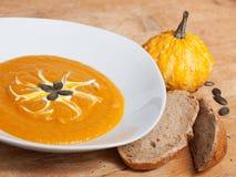Delicious pumpkin cream soup. Served delicious pumpkin cream soup beautiful Royalty Free Stock Photography