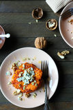 Delicious pumpkin pancakes with blue cheese Stock Images