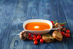 Delicious pumpkin soup with heavy cream on dark rustic wooden ta royalty free stock photos