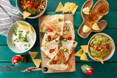 Delicious quesadillas with salsa. Delicious homemade quesadillas with fresh guacamole and tomato salsa stock image