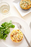 Delicious quiche. With lamb's lettuce and a glass of white wine Stock Photo