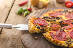 Delicious quiche with chorizo, nuts and sharp cheese Royalty Free Stock Image