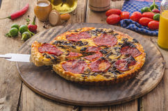 Delicious quiche with chorizo, nuts and sharp cheese Stock Photos