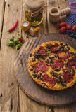 Delicious quiche with chorizo, nuts and sharp cheese Stock Photography