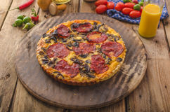Delicious quiche with chorizo, nuts and sharp cheese Royalty Free Stock Images