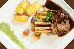 Delicious rack of lamb dish with roast vegetable and potatoes Royalty Free Stock Images