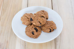 Delicious raisin cookies and a glass of milk Royalty Free Stock Photography