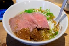Delicious Ramen stew made from beef, noodles, chicken broth, mushrooms, corn . Served with traditional sauces. In japan trip royalty free stock photography