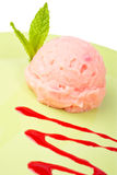 Delicious raspberries ice cream. With syrup in green plate. Shallow depth of field Stock Image