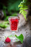 Delicious raspberries liqueur made of alcohol and fruits Stock Photo