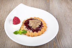 Delicious raspberry cake with mint and almond cream Royalty Free Stock Photo