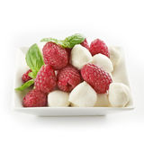 Delicious raspberry salad with mozarella and basil Royalty Free Stock Images