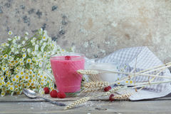 Delicious raspberry smoothie or milk shake with fresh berries. F. Resh yogurt with raspberry. Healthy breakfast Royalty Free Stock Photo
