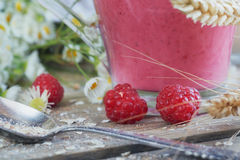Delicious raspberry smoothie or milk shake with fresh berries. F. Resh yogurt with raspberry. Healthy breakfast Stock Photo