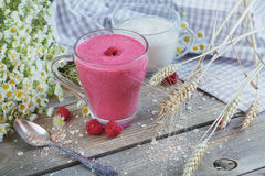 Delicious raspberry smoothie or milk shake with fresh berries. F Royalty Free Stock Photography