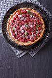 Delicious raspberry tart with cream and mint vertical top view Stock Images