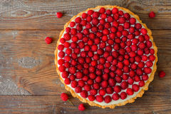 Delicious raspberry tart on a wooden board Stock Images