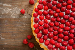 Delicious raspberry tarts on a wooden board Stock Photos