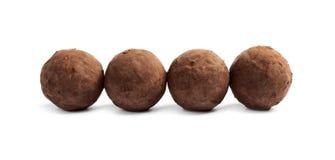 Delicious raw chocolate truffles. On white background stock photo