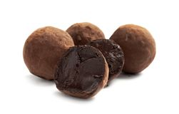 Delicious raw chocolate truffles. On white background royalty free stock photography
