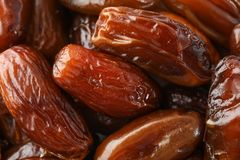 Delicious raw organic dates as background stock images