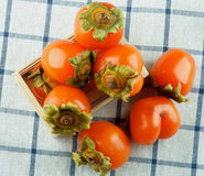 Delicious Raw Persimmon Royalty Free Stock Photography