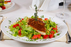 Delicious Recipe on Frisee Lettuce on White Plate Royalty Free Stock Photo