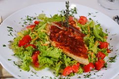 Delicious Recipe on Frisee Lettuce on White Plate Royalty Free Stock Image