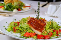 Delicious Recipe on Frisee Lettuce on White Plate Stock Photo