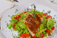 Delicious Recipe on Frisee Lettuce on White Plate Royalty Free Stock Photography