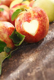Delicious red apple with heart cutout Stock Image