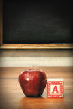 Delicious red apple on school desk Stock Images