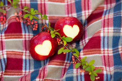 Delicious red apple with symbolic heart. Cutout on rough Stock Photo