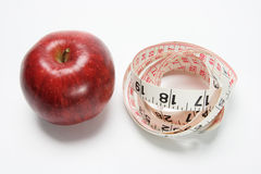 Delicious Red Apple and Tape Measure Stock Photo