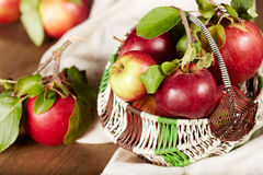 Delicious red apples in basket Stock Photos