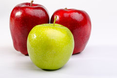 Delicious Red Apples and Granny Smith Apple. On white background royalty free stock image