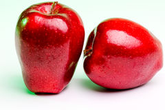 Delicious Red Apples on Green Lighting. Delicious Red Apples with green rim lighting royalty free stock photo
