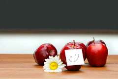 Delicious Red Apples On Desk With Blackboard Royalty Free Stock Images