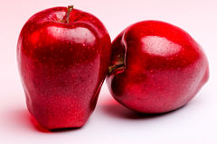 Delicious Red Apples on White Background. Red background lighting royalty free stock photography