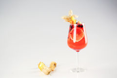 Delicious red cocktail with fruits. In studio Royalty Free Stock Photo