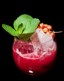 Delicious red cocktail on the rocks with mint Royalty Free Stock Photo