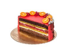 Delicious red fruit and chocolate cake in a cut. Medronho Stock Photography