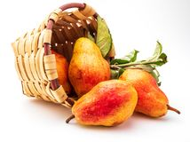 Delicious red pears in wicker basket. stock images
